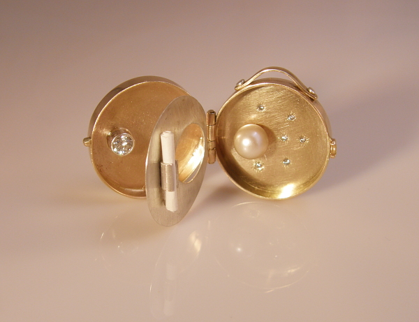Gold and silver locket with diamonds and pearl, all recycled materials