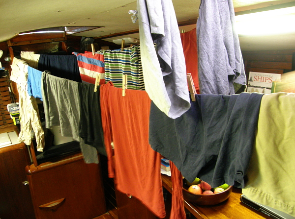 Laundry drying on a line inside a sailboat.