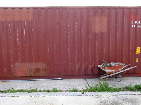 Wheelbarrow in front of container