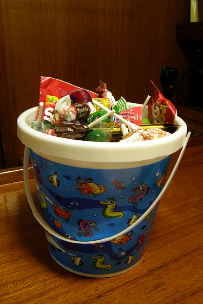 Plastic beach bucket filled with Halloween candy