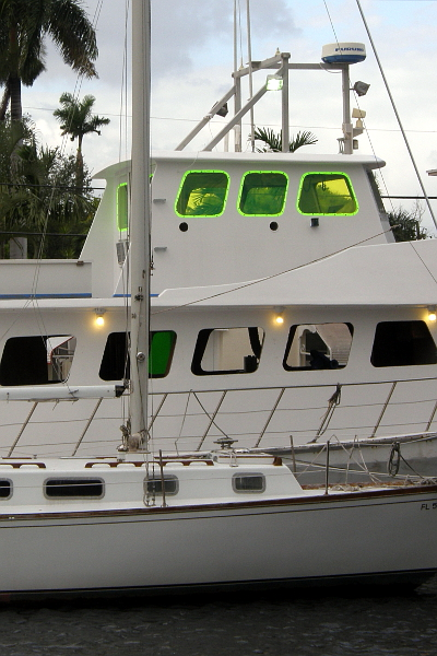Fishing boat being refitted with neon plexiglass windows.