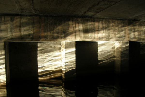 Sunlight plays on the walls underneath a low bridge in Miami.