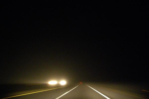 Highway on a dark, misty night.