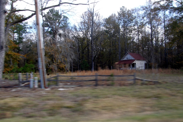 Blurry Alabama countryside with small house at 55 mph