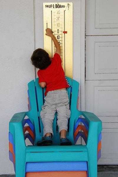 Boy moving shuffleboard score board