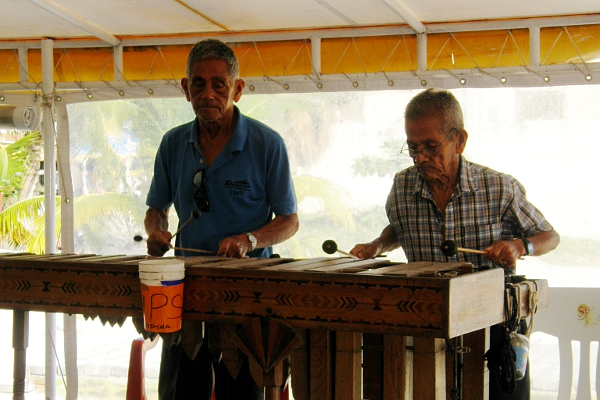 Two men playing a xylophone.
