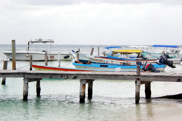 Boats lined up at the beach in Isla Mujeres