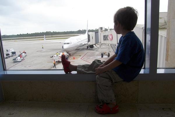 Boy looking at airplane