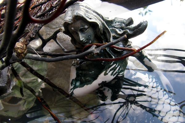 Mermaid sculpture in water