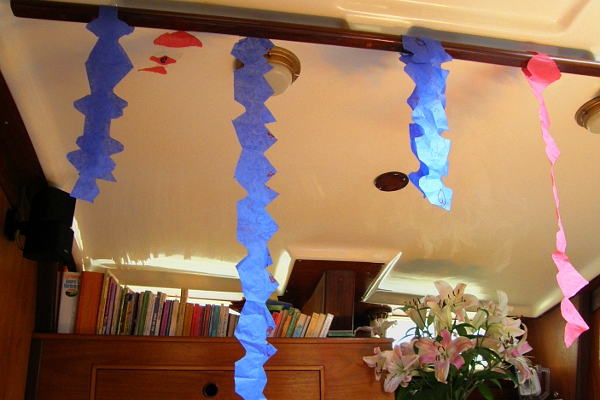 Home made tissue paper streamers hanging from ceiling of the boat.