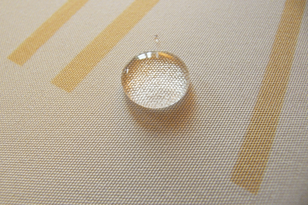 Bead of water on dirt repelling tablecloth