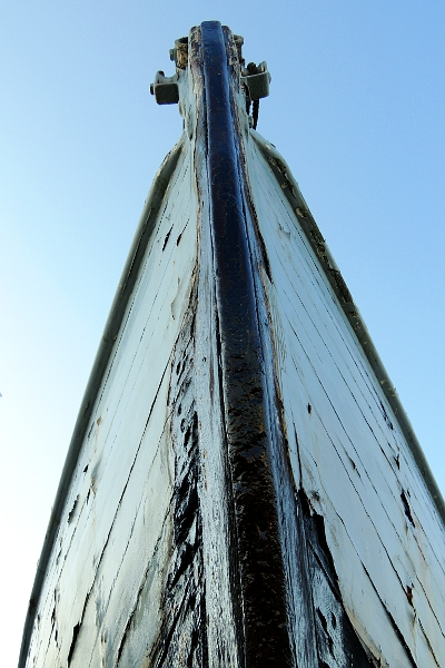 Bow of a wood boat in boat yard