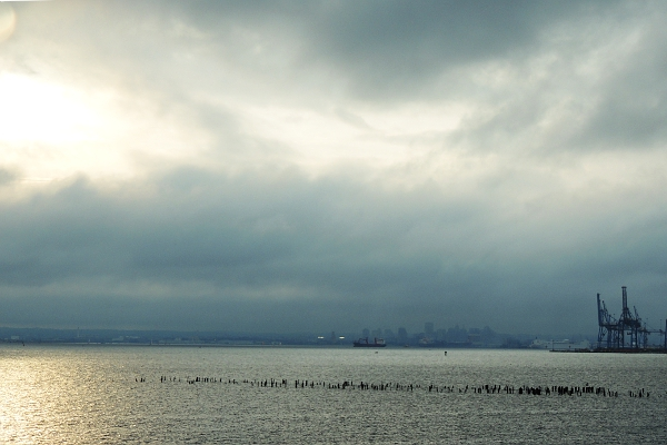 Cloudy rainy day over Chesapeake Bay with sun breaking through the clouds
