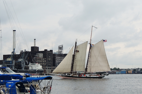 Schooner Lady Maryland sailing through Baltimore harbor.