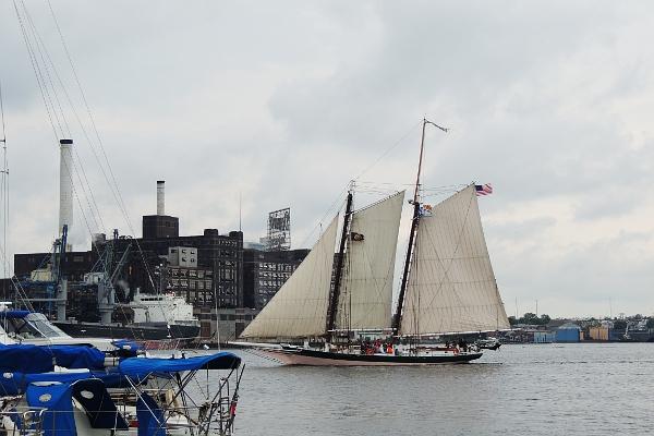 Schooner Lady Maryland sailing through Baltimore harbor.