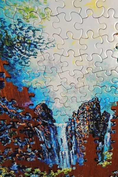 Unfinished jigsaw puzzle of waterfall