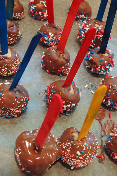 Cake pops dipped in chocolate and sprinkles