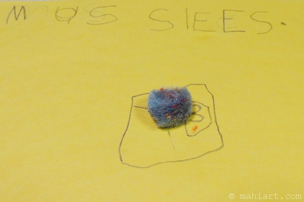 Child's craft, drawing, and writing of a sleeping mouse