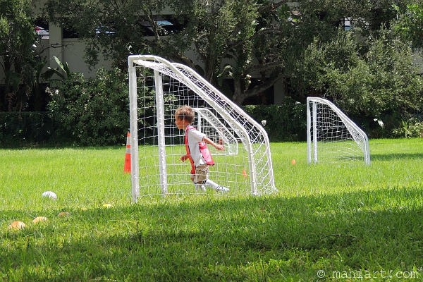 Boy in soccer goal, getting ready for his first match