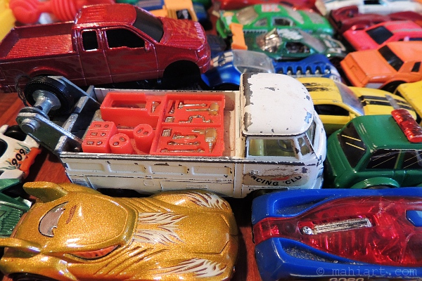 Toy cars parked closely together