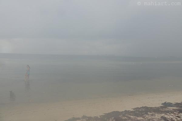 Beach scene on a cloudy day as seen through a fogged up lens