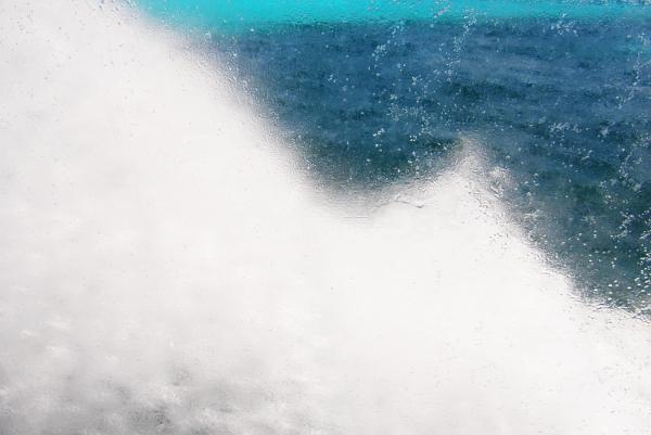Salt water splashing against ferry boat window.