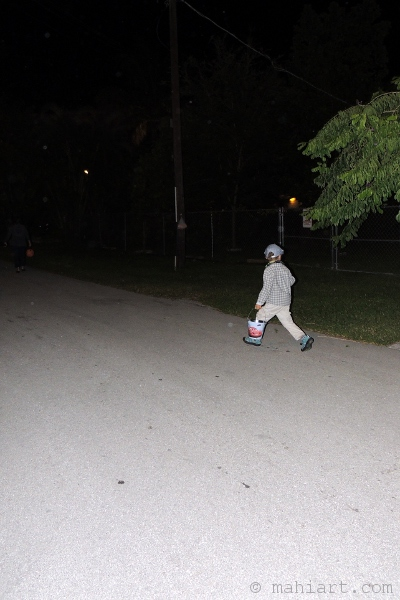 Boy running to the next trick or treat house.