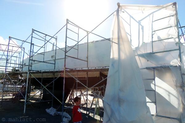 Boat in scaffolding in boat yard