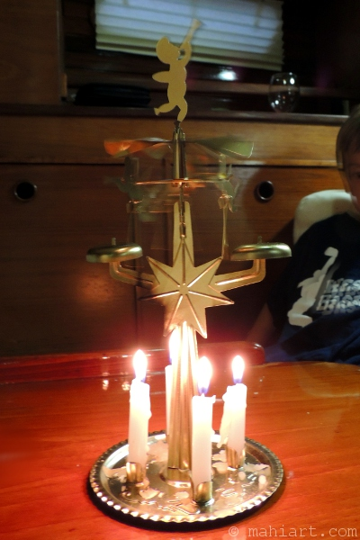 old fashioned angel mobile with candles
