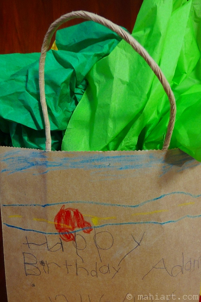 Kraft paper gift bag with child's drawing