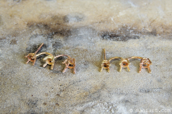 14k gold earrings unfinished on a jewelers bench