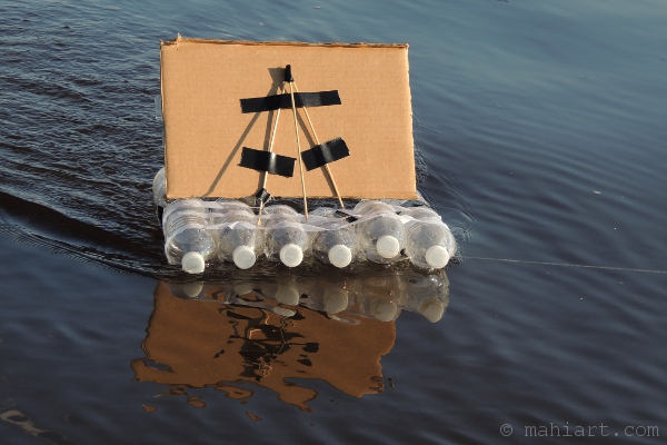 boat made of water bottles and cardboard