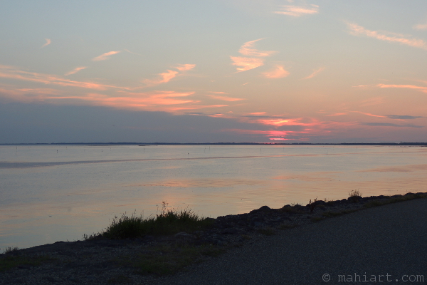 Sunset over the water of the Oosterschelde, as seen from the dike near Zierikzee