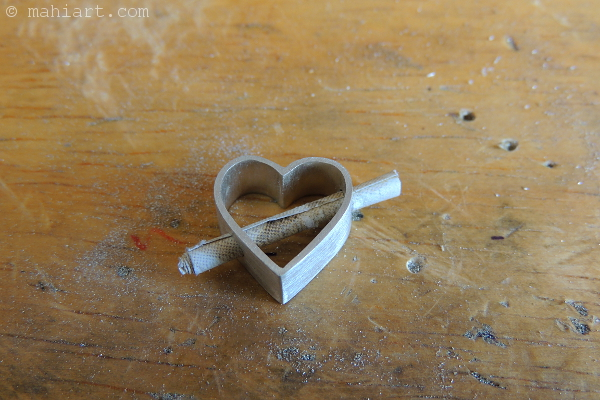 Through The Heart - Heart shaped sterling silver message pendant in the making
