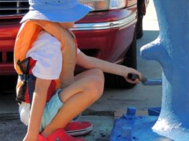 Painting the bollards blue.